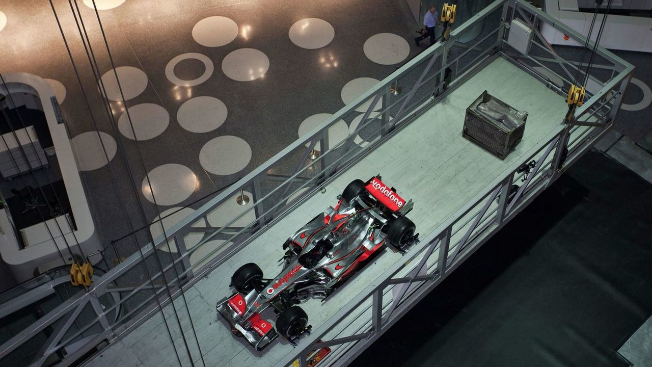 McLaren MP4-23 lifted by crane into new resting place at the Mercedes-Benz Museum