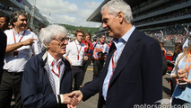 Bernie Ecclestone with Marco Tronchetti Provera Pirelli Chairman on the grid