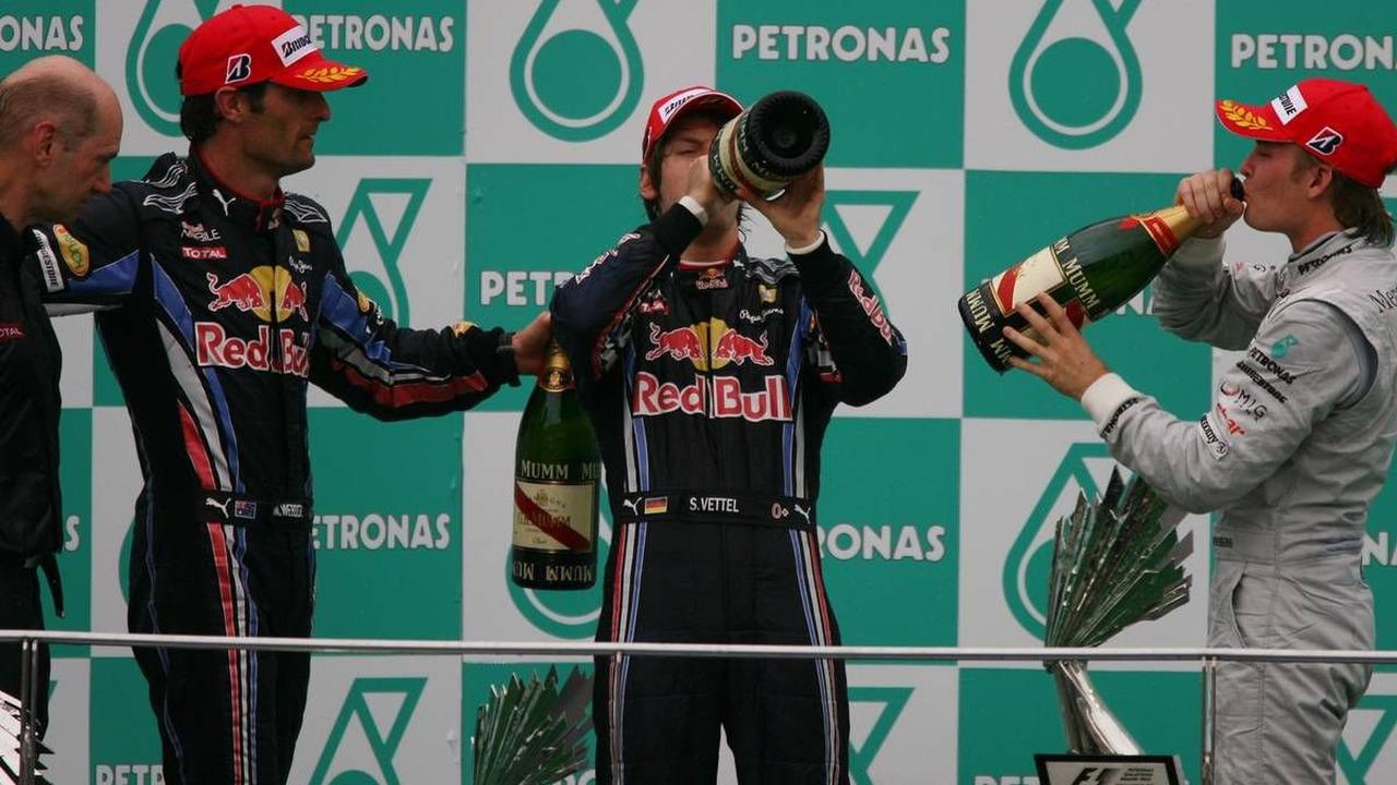 1st place Sebastian Vettel (GER), Red Bull Racing with 2nd place Mark Webber (AUS), Red Bull Racing and 3rd place Nico Rosberg (GER), Mercedes GP Petronas, Malaysian Grand Prix, 04.04.2010 Kuala Lumpur, Malaysia