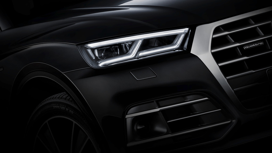 New Audi Q5 teasers show lighting tech, trunk space