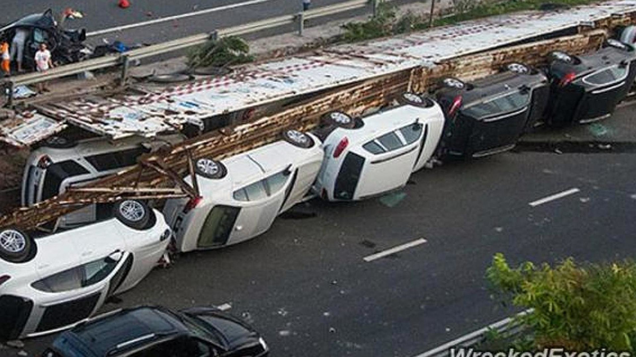 Overturned truck carrying high-end cars