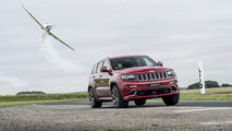 Jeep Grand Cherokee SRT races stunt plane around track