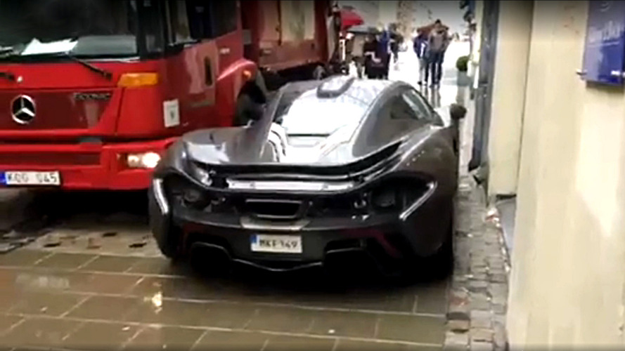 Watch a McLaren P1 driver bravely squeeze past a truck