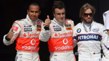 Pole winner Fernando Alonso, second, Lewis Hamilton, third, Nick Heidfeld