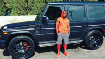 Kevin Hart dwarfed by his new Mercedes-AMG G65