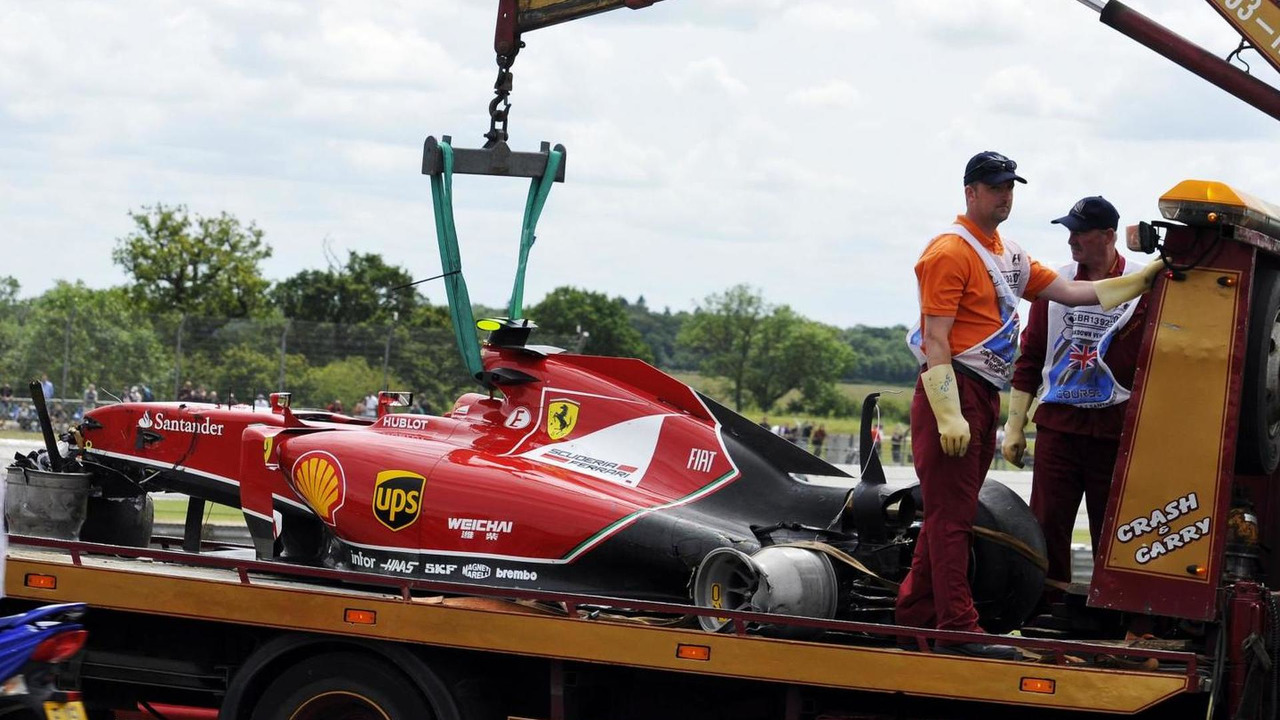 The Ferrari F14-T of Kimi Raikkonen (FIN) is recovered back to the pits on the back of a truck after he crashed heavily at the start of the race, 06.07.2014, British Grand Prix, Silverstone / XPB