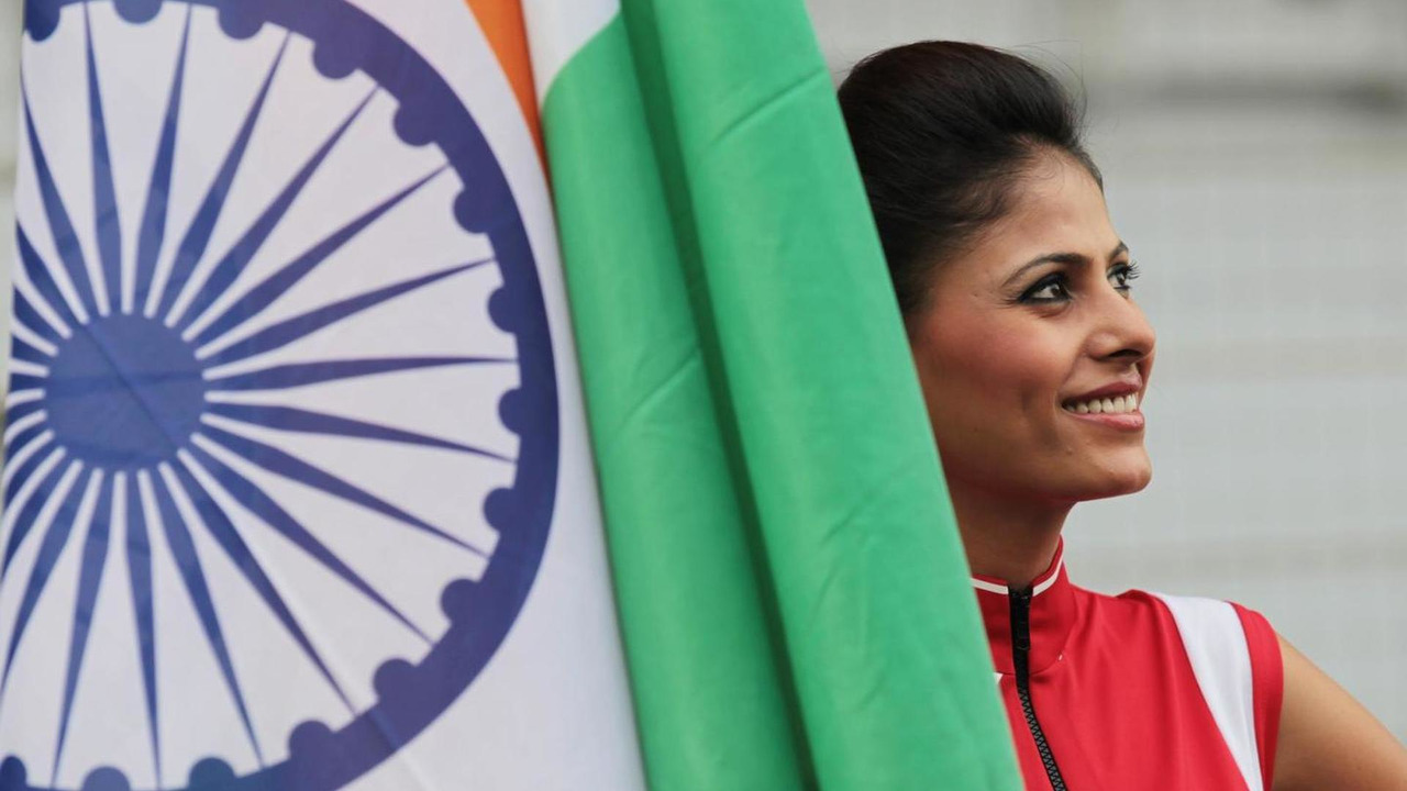 Grid girl with the Indian flag 28.10.2012 Indian Grand Prix