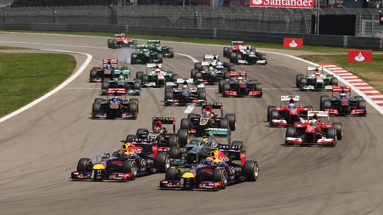 (L to R): Sebastian Vettel (GER) Red Bull Racing RB9 and Mark Webber (AUS) Red Bull Racing RB9 lead at the start of the race