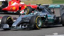 Nico Rosberg, Mercedes AMG F1 Team and Sebastian Vettel, Scuderia Ferrari