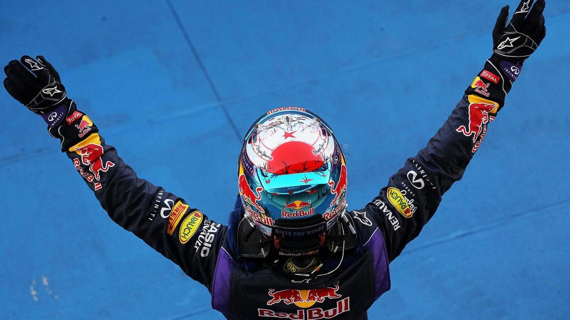Vettel 'walking it' at top of F1 tree - Hamilton