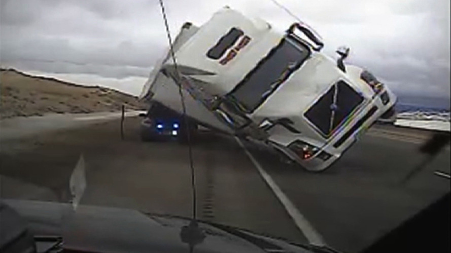 Watch a police car get crushed by blown over semi truck