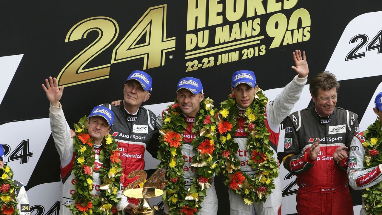 2013 24 Hours of Le Mans podium Allan McNish (GB), Dr. Wolfgang Ullrich (Head of Audi Sport), Tom Kristensen (DK), Loïc Duval (F), Ralf Jüttner (Technical Director Audi Sport Team Joest)  23.6.2013