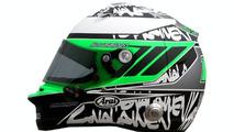 Kovalainen to wear green helmet in 2010