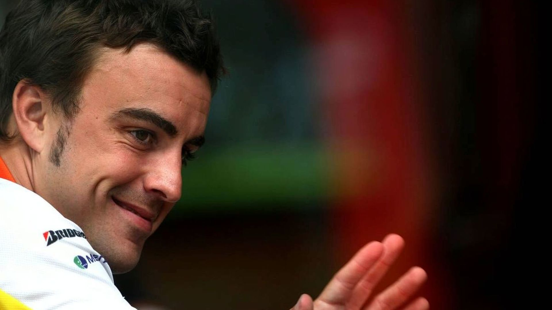 Alonso grins at Ferrari rumours at Spa
