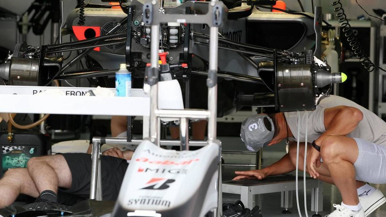 Michael Schumacher (GER), Mercedes GP Petronas takes a look at his car, German Grand Prix, 22.07.2010 Mannheim, Germany