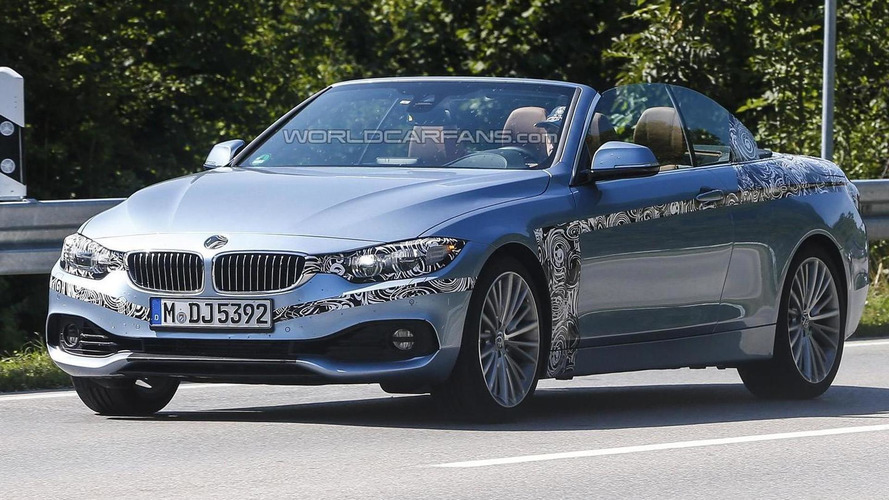 2014 BMW 4-Series Convertible spied with the top down wearing minimal camo