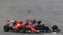 Kimi Raikkonen, Ferrari SF15-T and Carlos Sainz Jr., Scuderia Toro Rosso STR10 battle for position