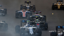 Valtteri Bottas, Williams FW38, leads Jenson Button, McLaren MP4-31 and Romain Grosjean, Haas VF-16, at the start