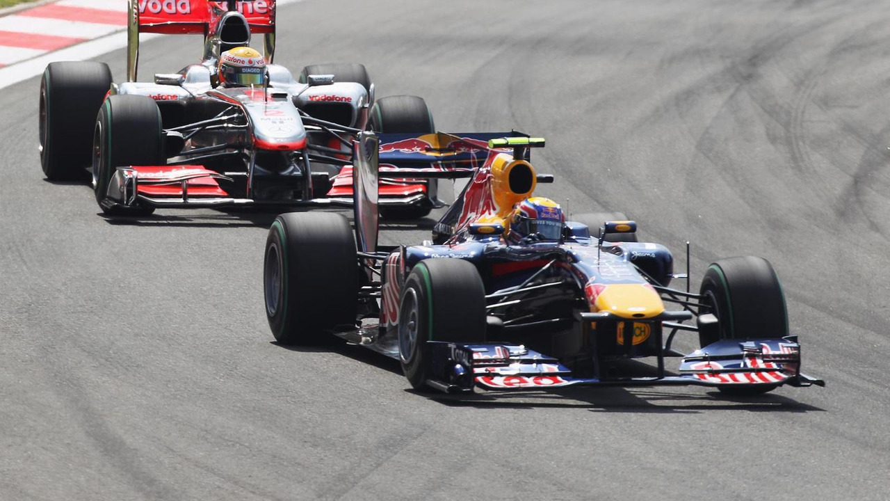 Mark Webber of Australia and Red Bull Racing leads from Lewis Hamilton of Great Britain and McLaren Mercedes at the start of the Turkish Formula One Grand Prix