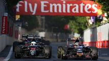 Fernando Alonso, McLaren MP4-31 and Carlos Sainz Jr., Scuderia Toro Rosso STR11 battle for position