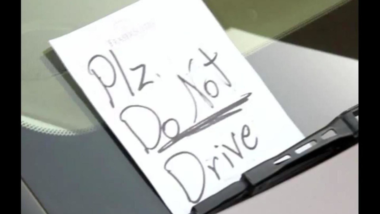 A note left on the car of a woman seen driving in Saudi Arabia