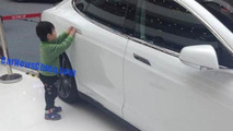 5-year-old kid hits baby in a Tesla Model S
