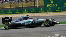 Lewis Hamilton, Mercedes AMG F1 Team W07 locks up under braking with a broken front wing