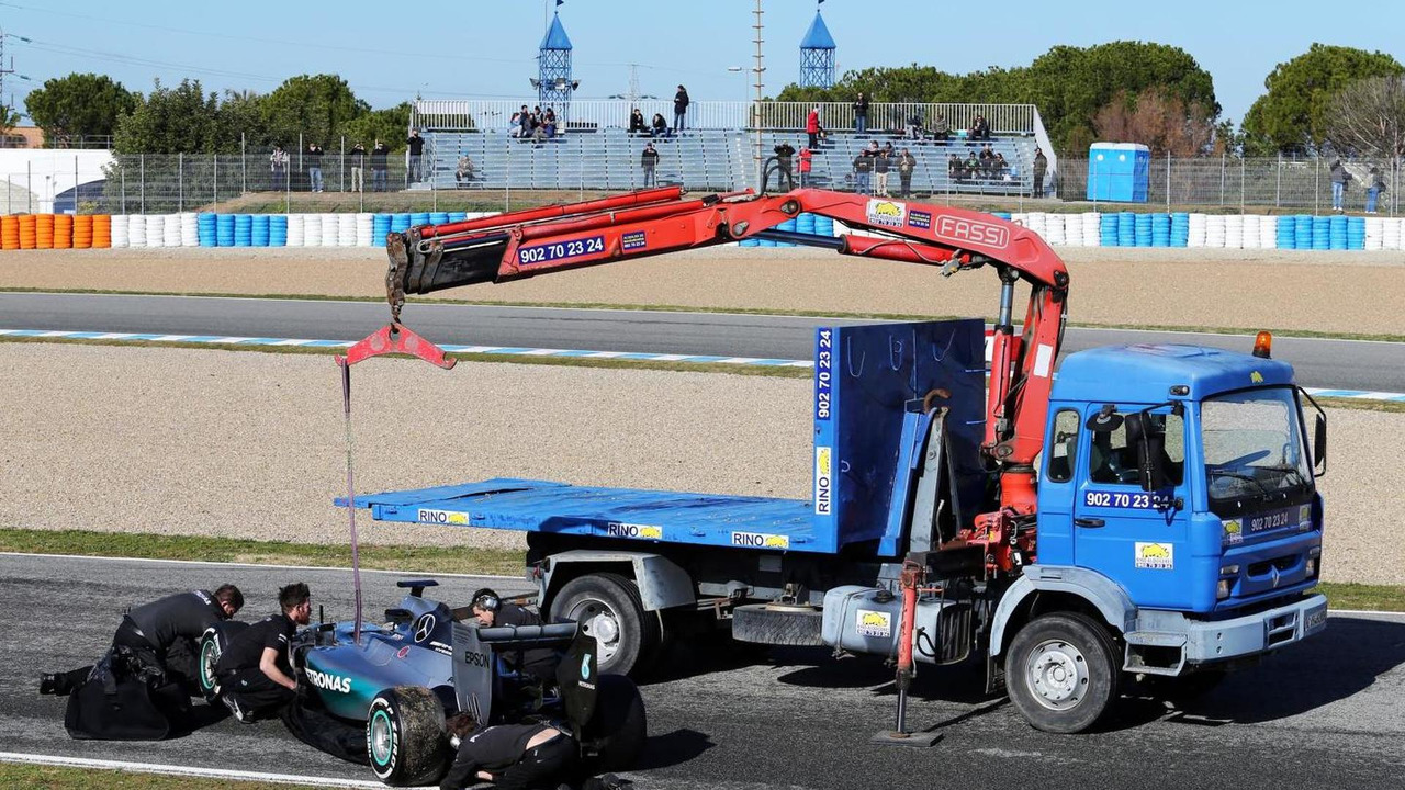 The Mercedes AMG F1 W06 of Lewis Hamilton (GBR) Mercedes AMG F1 is recovered back to the pits on the back of a truck, 04.02.2015, Formula One Testing, Day Four, Jerez, Spain / XPB