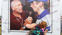 Fans sign a board containing messages of support for Murray Walker 29.06.2013 British Grand Prix