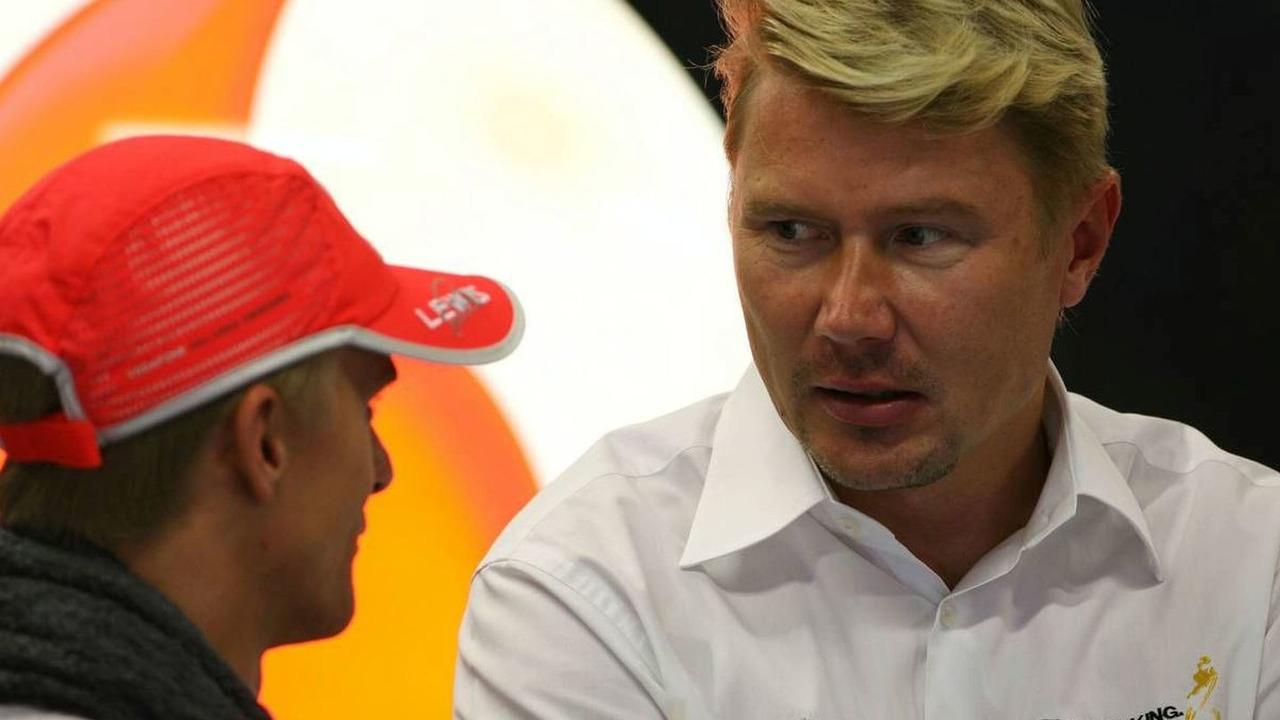 Heikki Kovalainen (FIN), McLaren Mercedes and Mika Hakkinen (FIN), Singapore Grand Prix, Friday Practice, 25.09.2009