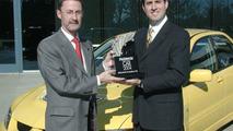 Mitsubishi EVO award - Left, Ian Beavis, SVP MMNA