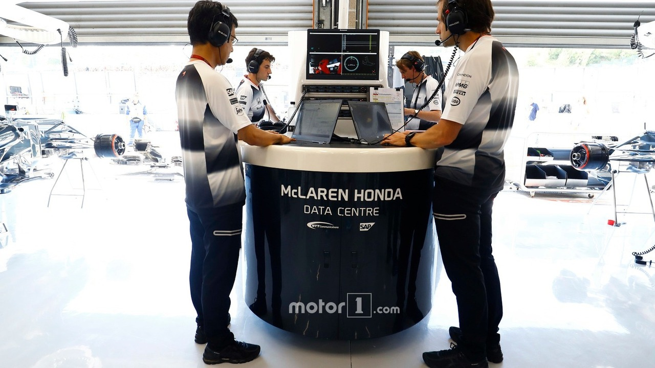 Ciaron Pilbeam, McLaren Chief Race Engineer works alongside colleagues in the pit garage