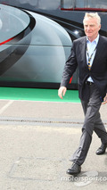 Max Mosley FIA President walking away from Bernie Ecclestone's motorhome