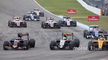 Daniil Kvyat, Scuderia Toro Rosso STR11; Sergio Perez, Sahara Force India F1 VJM09; and Jolyon Palmer, Renault Sport F1 Team RS16 at the start of the race