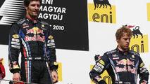 Mark Webber (AUS), Red Bull Racing first, Sebastian Vettel (GER), Red Bull Racing third - Formula 1 World Championship, Rd 12, Hungarian Grand Prix, Sunday Podium