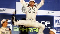 2015 champion Mark Webber celebrates on the podium