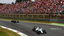 Felipe Massa, Williams FW38 Mercedes, leads Fernando Alonso, McLaren MP4-31 Honda