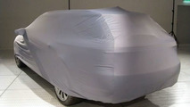 Showroom ready 2010 Saab 9-5 caught hiding under car cover