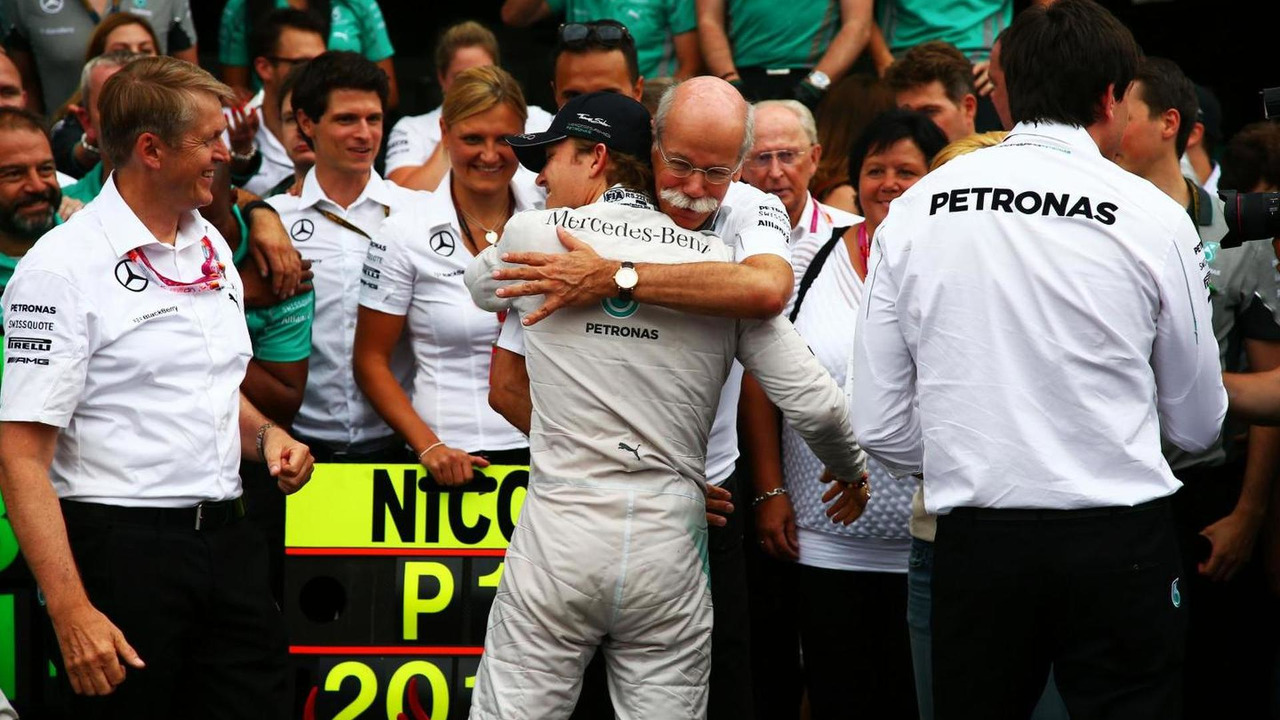 Race winner Nico Rosberg (GER) celebrates with Dr. Dieter Zetsche (GER) and the team, 20.07.2014, German Grand Prix, Hockenheim / XPB