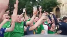 Irish football hooligans repair car damaged during march