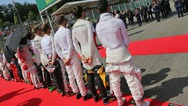 (L to R): Nico Hulkenberg, Sahara Force India F1; Romain Grosjean, Haas F1 Team; Jenson Button, McLaren; Jolyon Palmer, Renault Sport F1 Team; and Pascal Wehrlein, Manor Racing, as the grid observes the national anthem