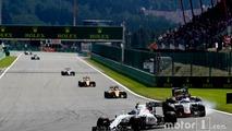 Valtteri Bottas, Williams FW38 Mercedes, leads Romain Grosjean, Haas VF-16 Ferrari