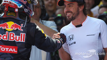 Race winner Max Verstappen celebrates in parc ferme with Fernando Alonso