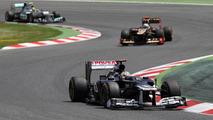 Pastor Maldonado, Williams FW34 Renault leads Kimi Raikkonen, Lotus E20 Renault and Nico Rosberg, Mercedes F1