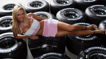 Model Bridget Lee lying on Michelin tires, United States Grand Prix, 29.06.2006 Indianapolis, USA