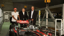 Lewis Hamilton, Norbert Haug and museum Managing Director, Michael Bock with the MP4-23.