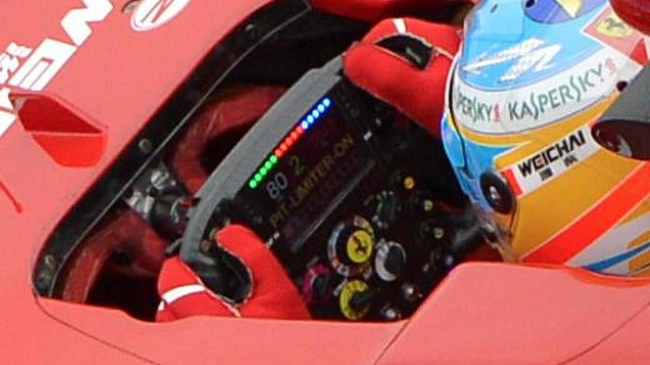 Fernando Alonso with McLaren PCU-8D LCD steering wheel display