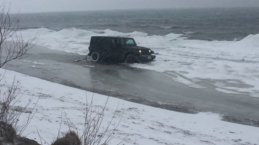Canadian Jeep Wrangler driver takes on frozen lake, loses
