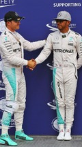 Nico Rosberg, Mercedes AMG F1 celebrates his pole position in parc ferme with second placed team mate Lewis Hamilton, Mercedes AMG F1