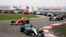 Lewis Hamilton, Mercedes AMG F1 W08, leads Sebastian Vettel, Ferrari SF70H, Valtteri Bottas, Mercedes AMG F1 W08, Kimi Raikkonen, Ferrari SF70H, Nico Hulkenberg, Renault Sport F1 Team RS17